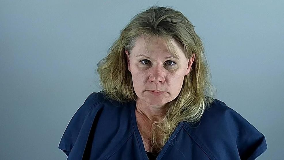 Woman accused of DUII and crashing into parked car while