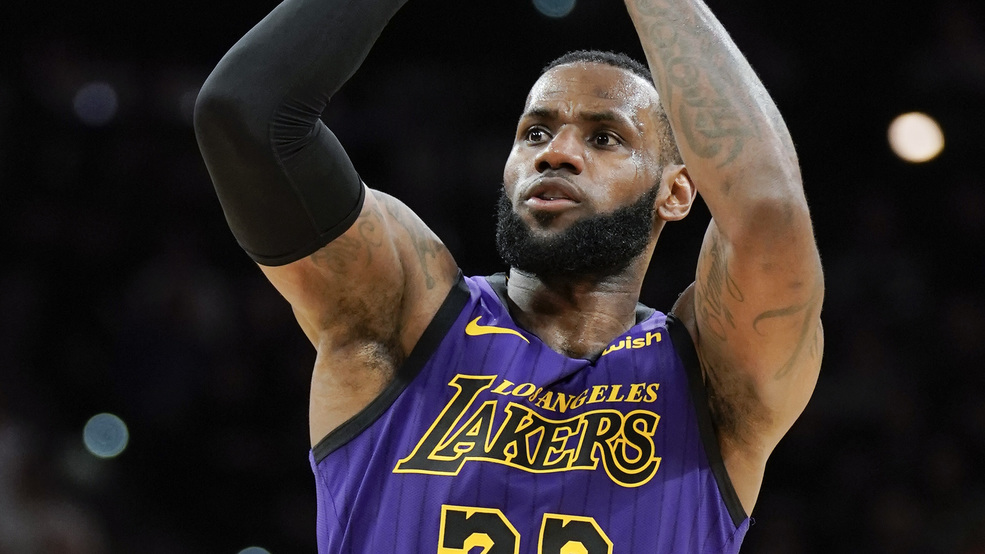 c190de1cf409 Los Angeles Lakers  LeBron James shoots during the first half of the team s  NBA basketball game against the San Antonio Spurs