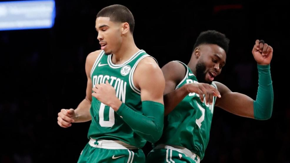 4ca1a0c3b103 Boston Celtics  Jayson Tatum (0) and Jaylen Brown (7) celebrate after Tatum  scored during the second half of an NBA basketball game against the  Brooklyn ...