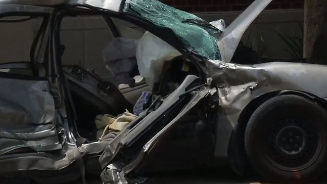 Passenger dead after small vehicle, truck collide at intersection in